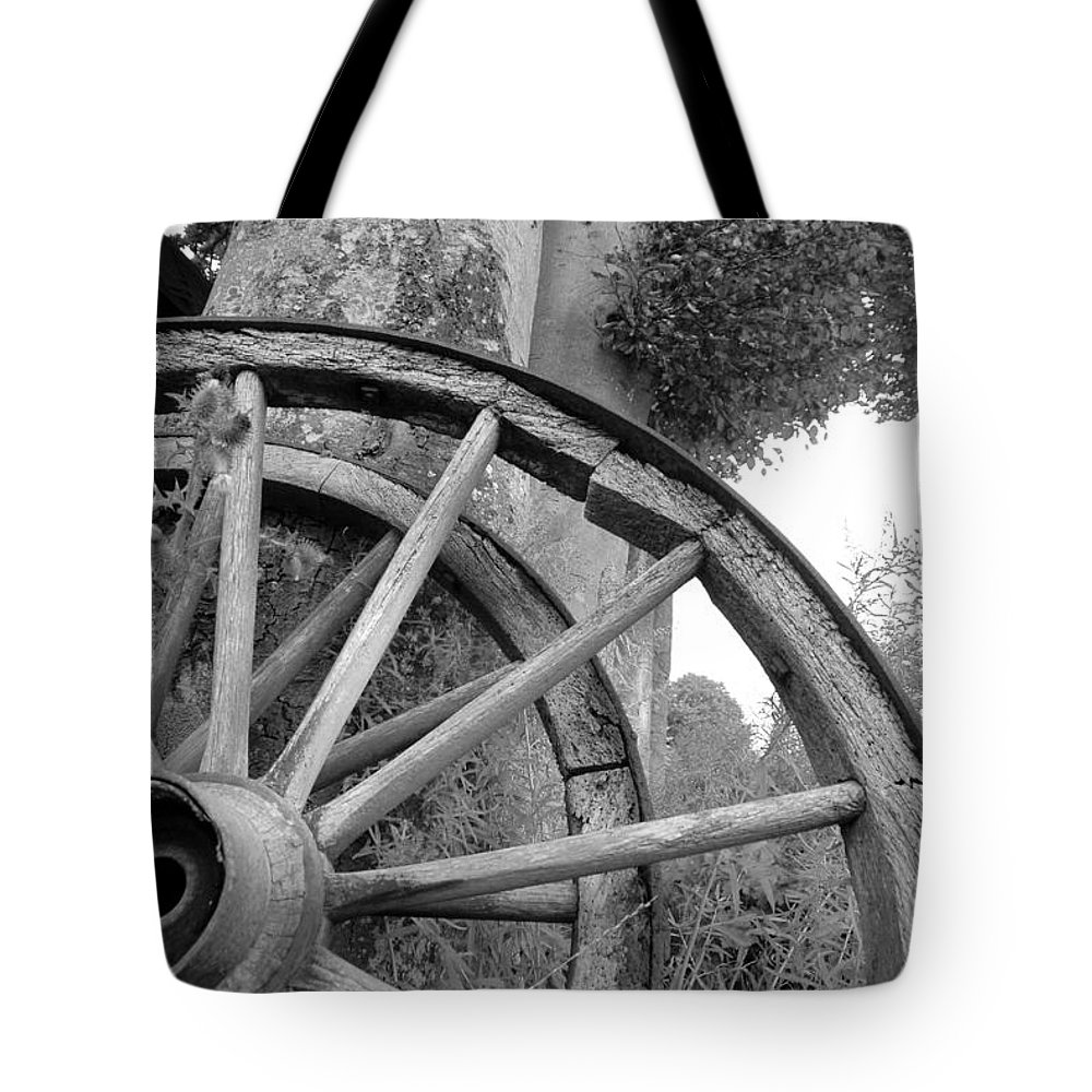 Wagon Wheels Tote Bag featuring the photograph Wagon Wheels by Robert Lacy
