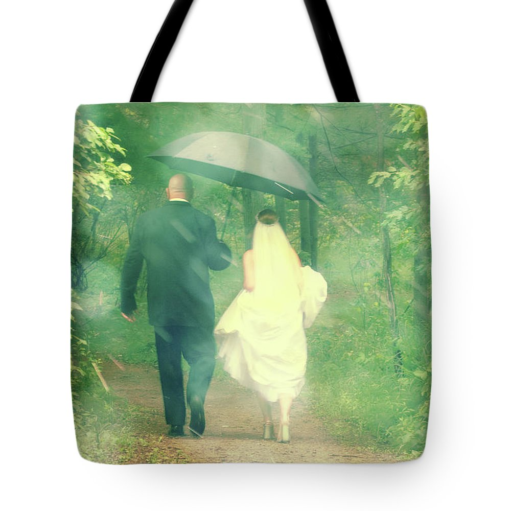 Walking Tote Bag featuring the photograph Walk In The Rain by Joel Witmeyer