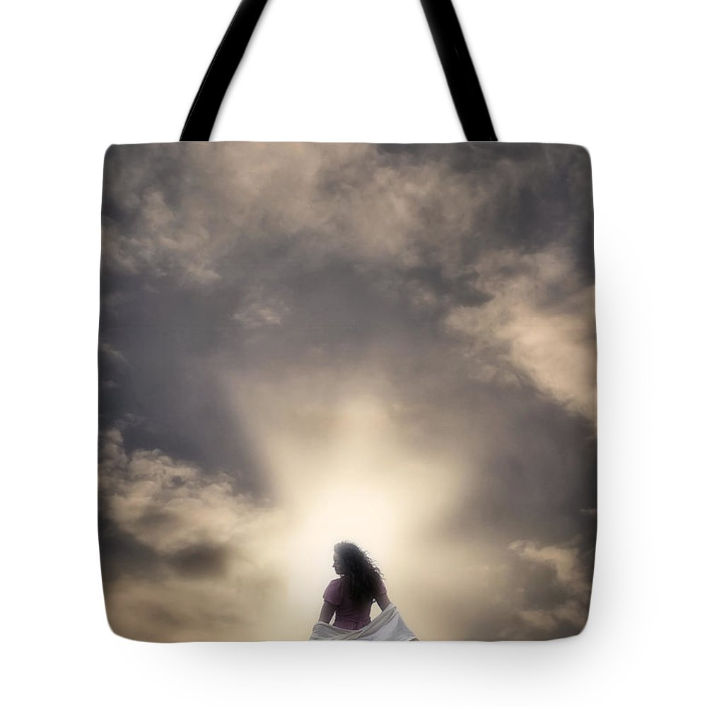 Woman Tote Bag featuring the photograph Walking Into The Sunset by Joana Kruse