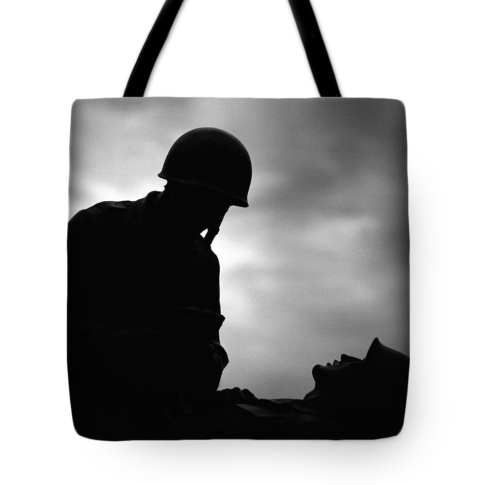 War Tote Bag featuring the photograph War by Carmine Taverna