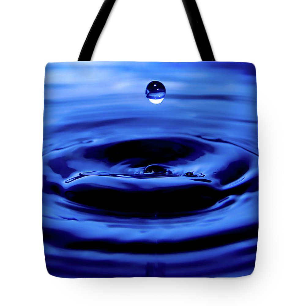 Tote Bag featuring the photograph Water Drop by Eric Ferrar