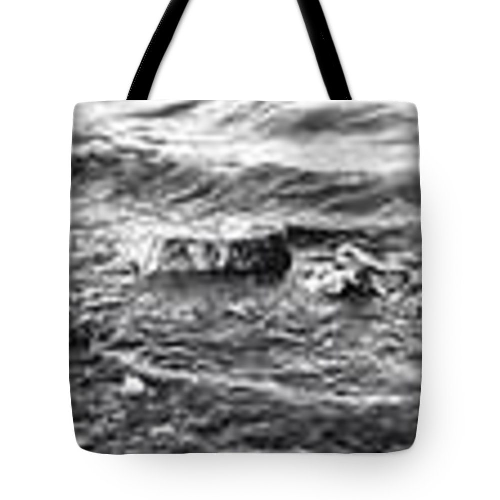 Rock Tote Bag featuring the photograph water over rock BW by Kayla Reno