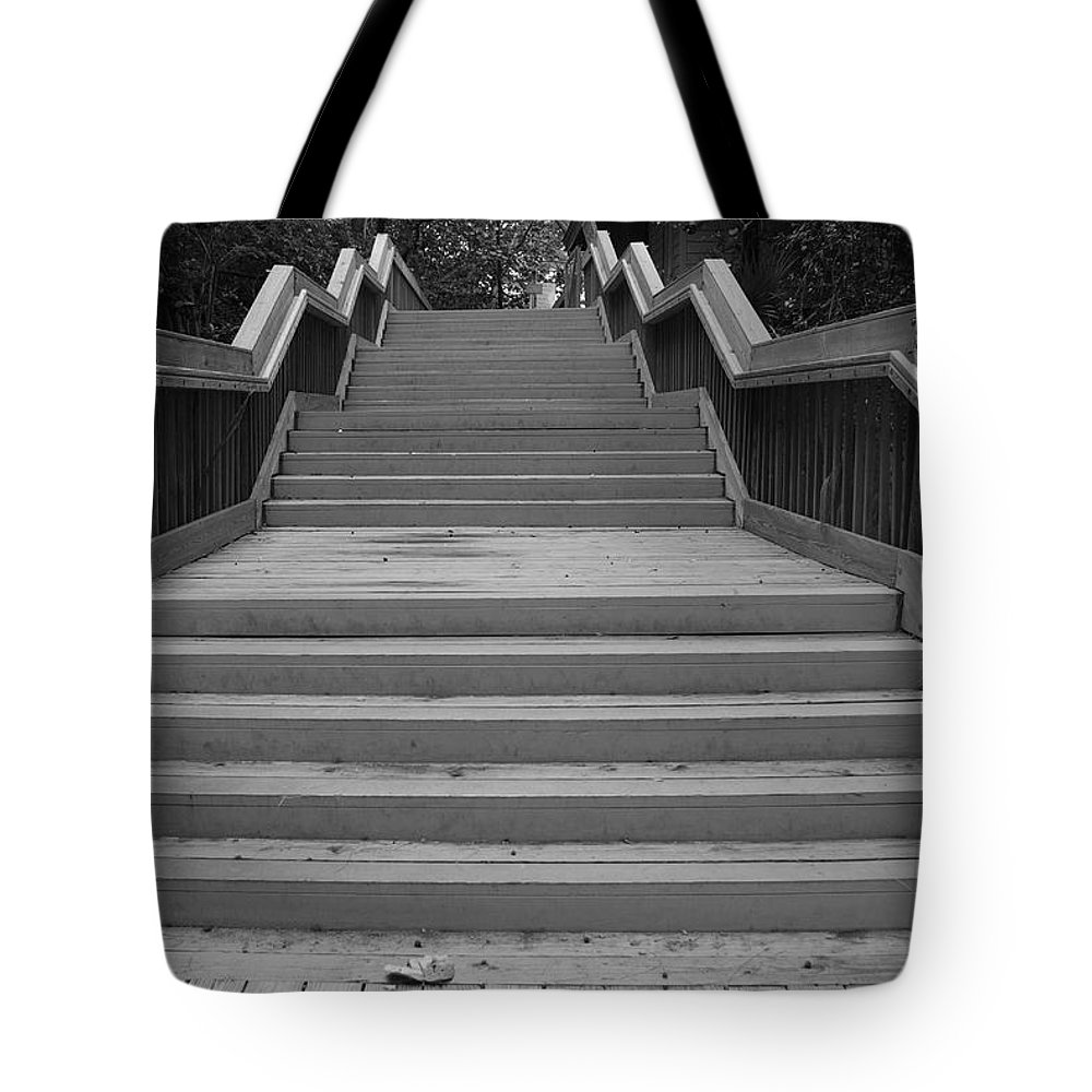 Black And White Tote Bag featuring the photograph Wavy Stairs by Rob Hans