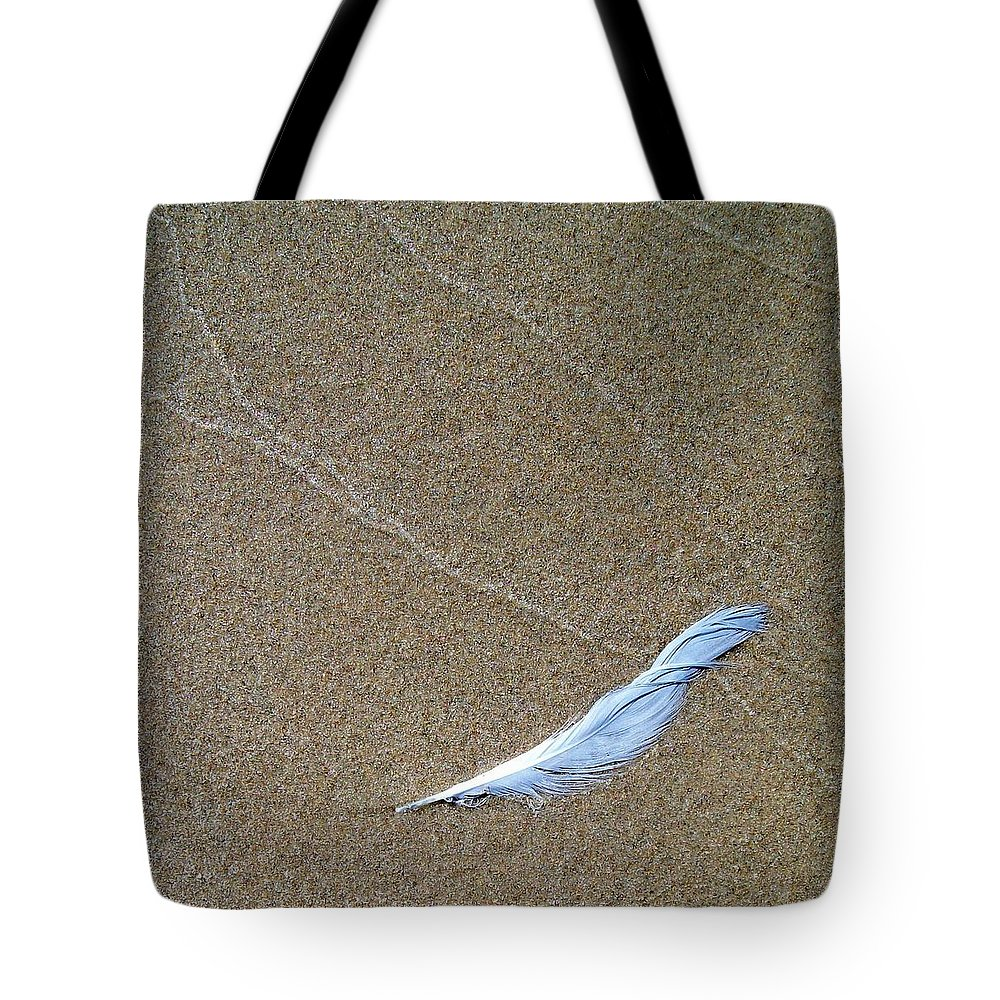 Zen Tote Bag featuring the photograph Weathered Feather by Michelle Calkins