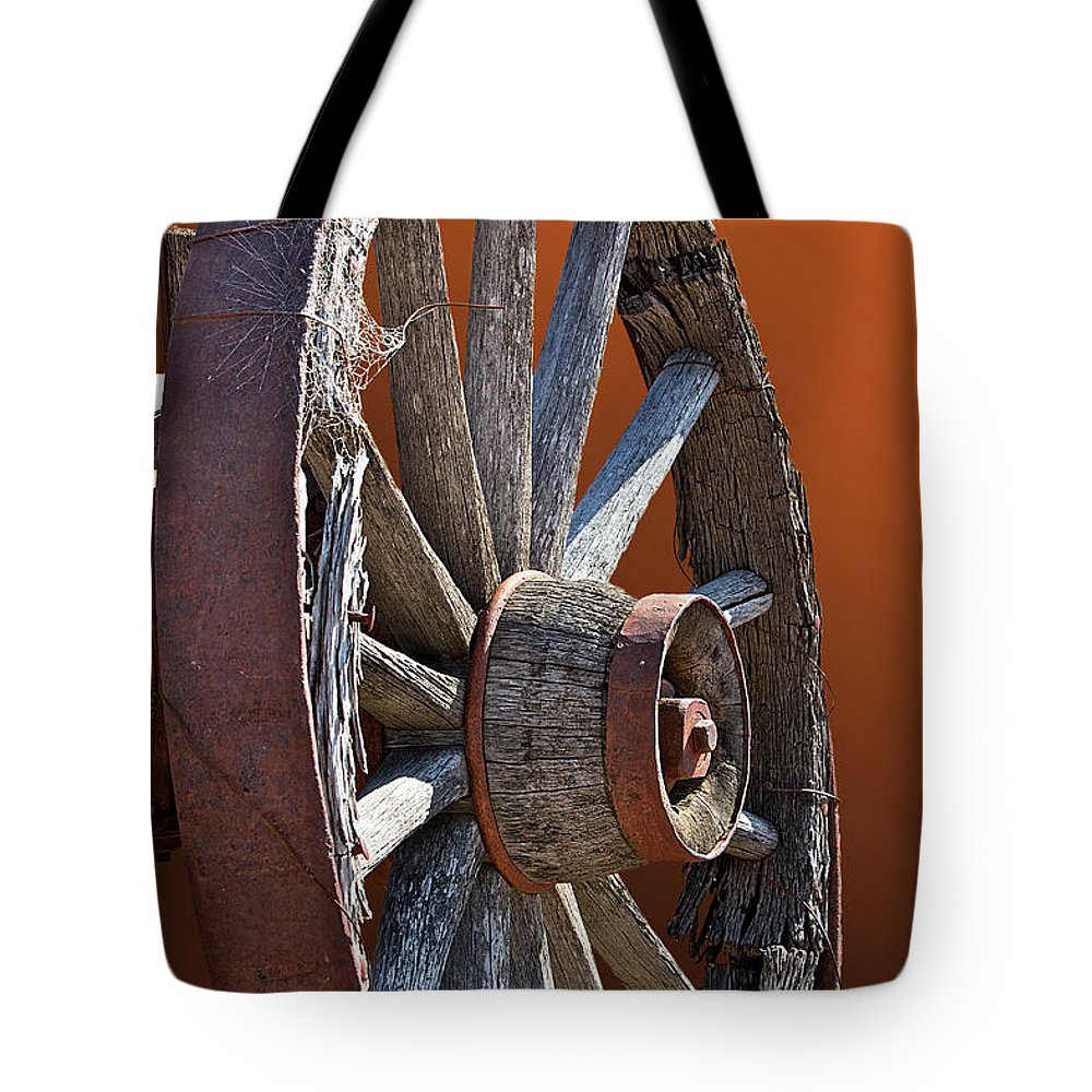 Wheel Tote Bag featuring the photograph Weathered Wagon Wheel by Phyllis Denton