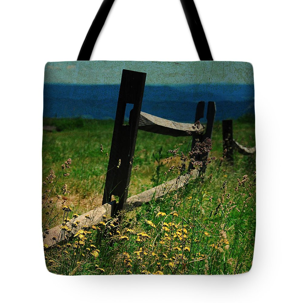 Fence Tote Bag featuring the photograph Weeds by Lois Bryan