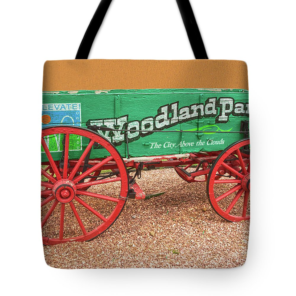 Historic Wagons Tote Bag featuring the photograph Woodland Park, Colorado, The City Above The Clouds, Elevation 8500 Feet, 2590 Meters Above Sea Level by Bijan Pirnia