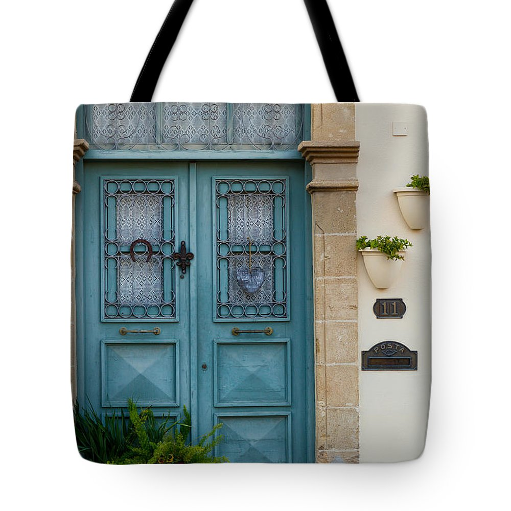 Cat Tote Bag featuring the photograph Welcoming Entrance And Strolling Cat by Iordanis Pallikaras