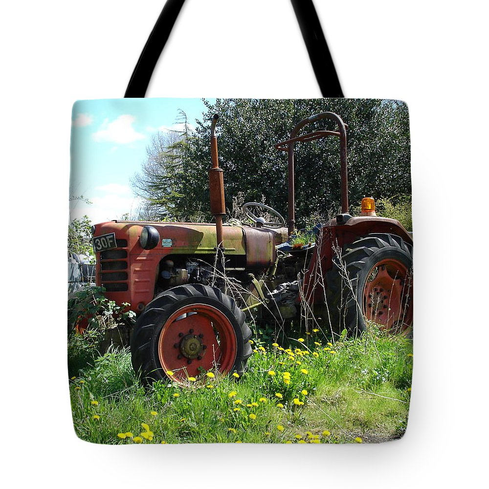 Tractor Tote Bag featuring the photograph Well And Truely Retired by Susan Baker