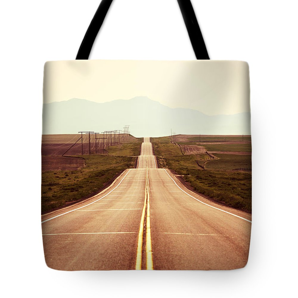 Middle Tote Bag featuring the photograph Western Road by Todd Klassy