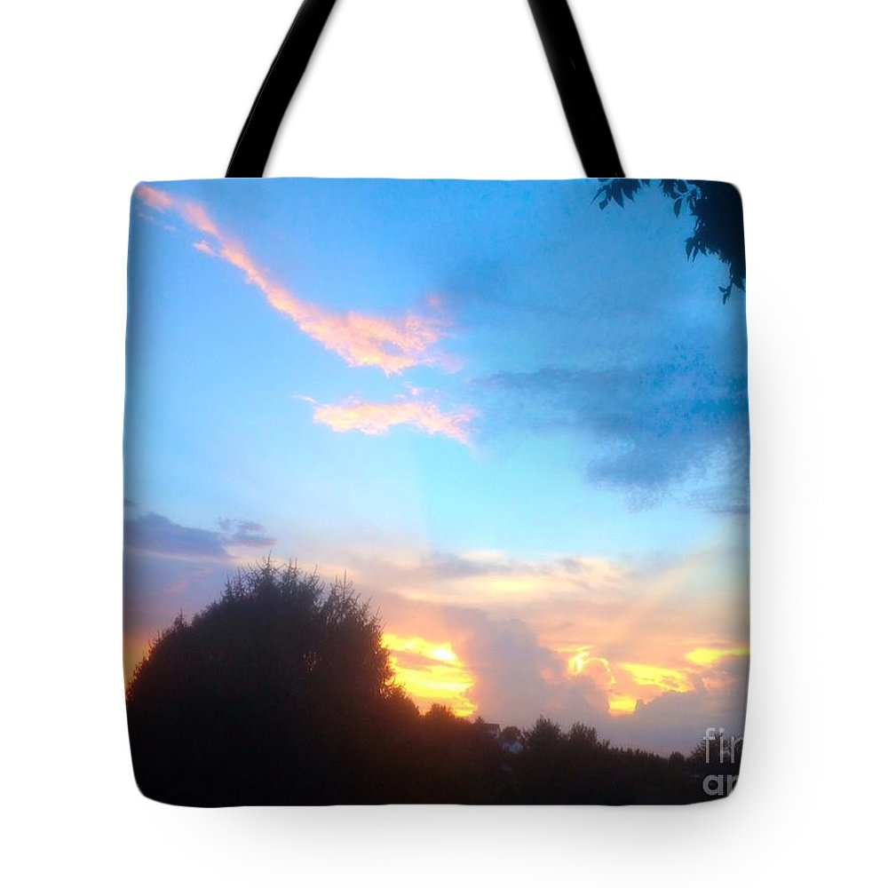 Sunset Tote Bag featuring the photograph What Dreams Are Made Of by Debra Lynch