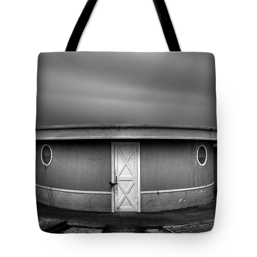 Beach Tote Bag featuring the photograph What Goes 'round Comes 'round by Evelina Kremsdorf