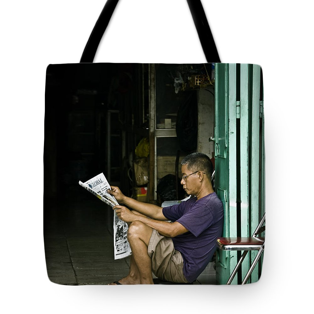 Newspaper Tote Bag featuring the photograph What's The News by Charuhas Images