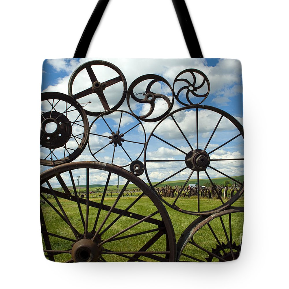 Wheels Tote Bag featuring the photograph Wheels by Louise Magno