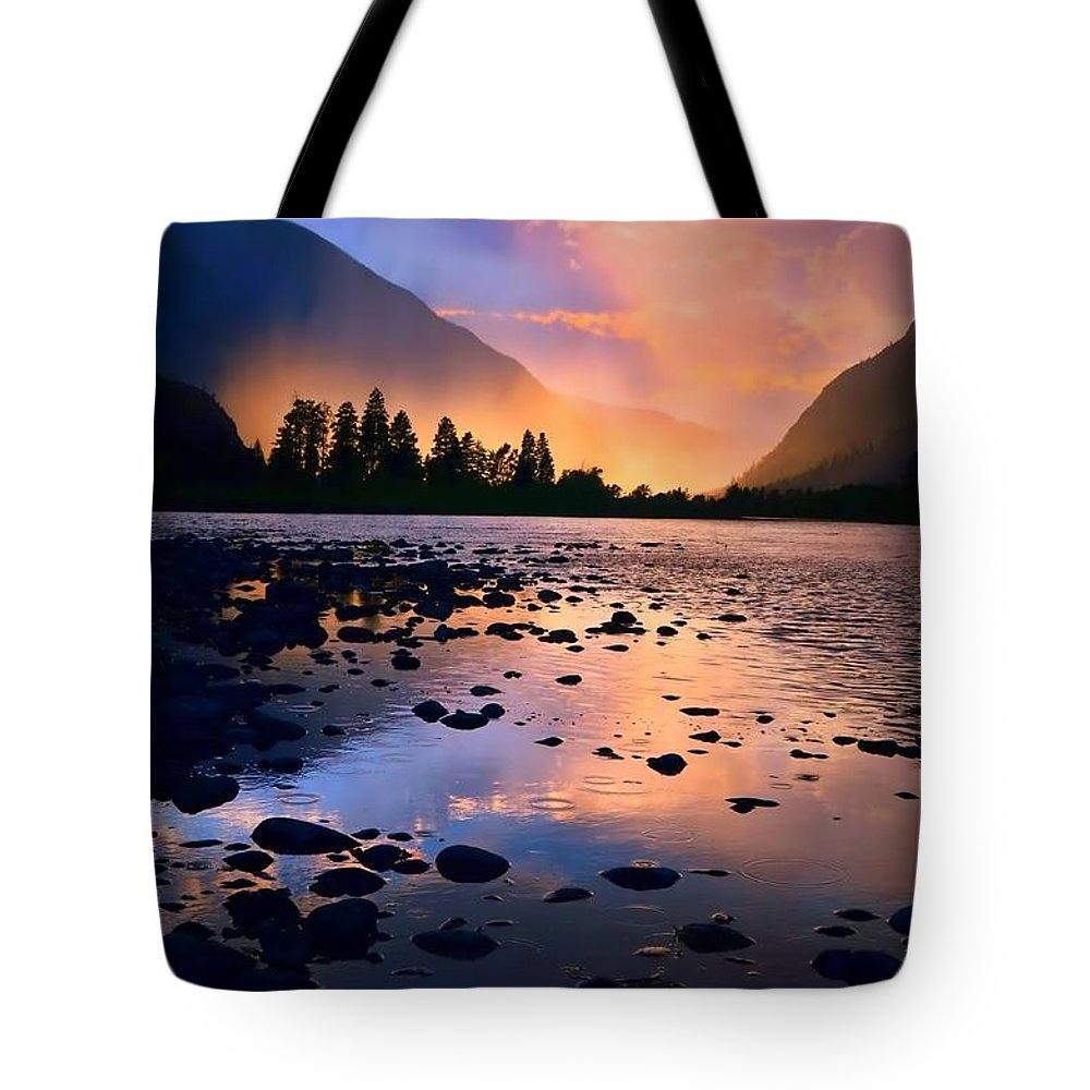 Rocks Tote Bag featuring the photograph When The Rain Falls And The Sun Sets by Tara Turner