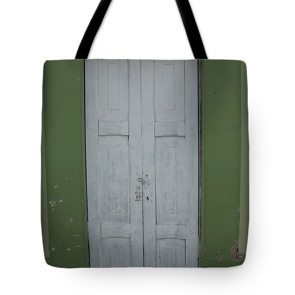 Door Tote Bag featuring the photograph White Door In A Green Wall by Robert Hamm
