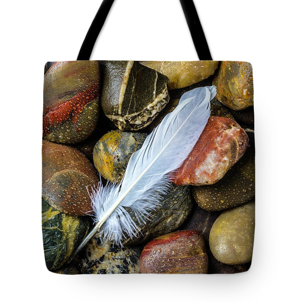 White Tote Bag featuring the photograph White Feather On River Stones by Garry Gay