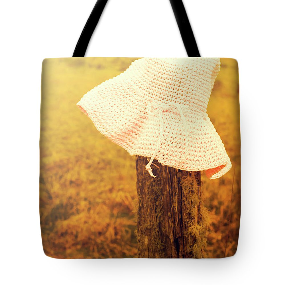 Female Tote Bag featuring the photograph White Knitted Hat On Farm Fence by Jorgo Photography - Wall Art Gallery