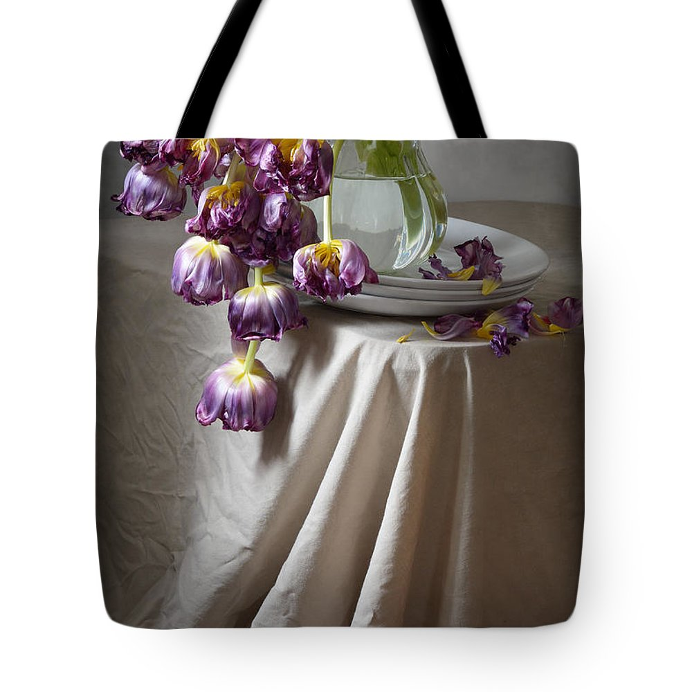 Floral Tote Bag featuring the photograph Wilted Bouquet Of Tulips by Nikolay Panov
