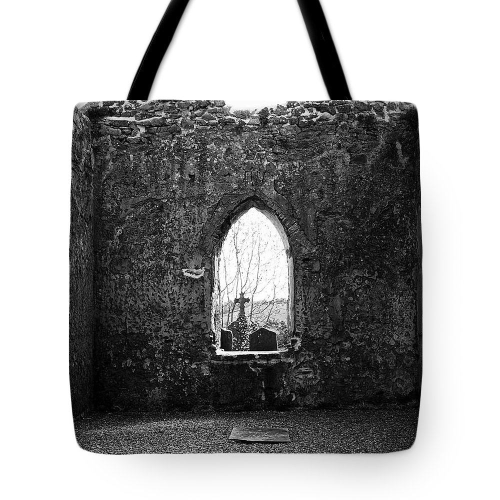 Ireland Tote Bag featuring the photograph Window at Fuerty Church Roscommon Ireland by Teresa Mucha