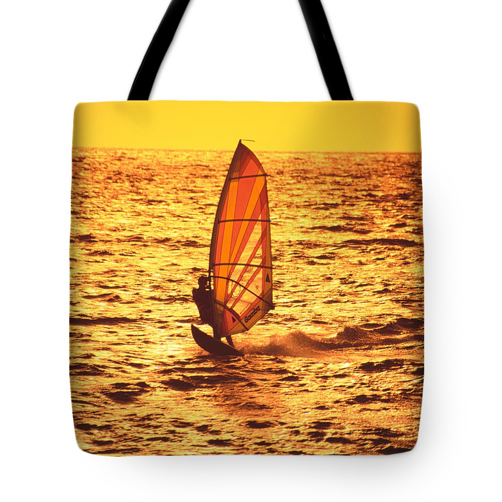 Afternoon Tote Bag featuring the photograph Windsurfer At Sunset by Dave Fleetham - Printscapes