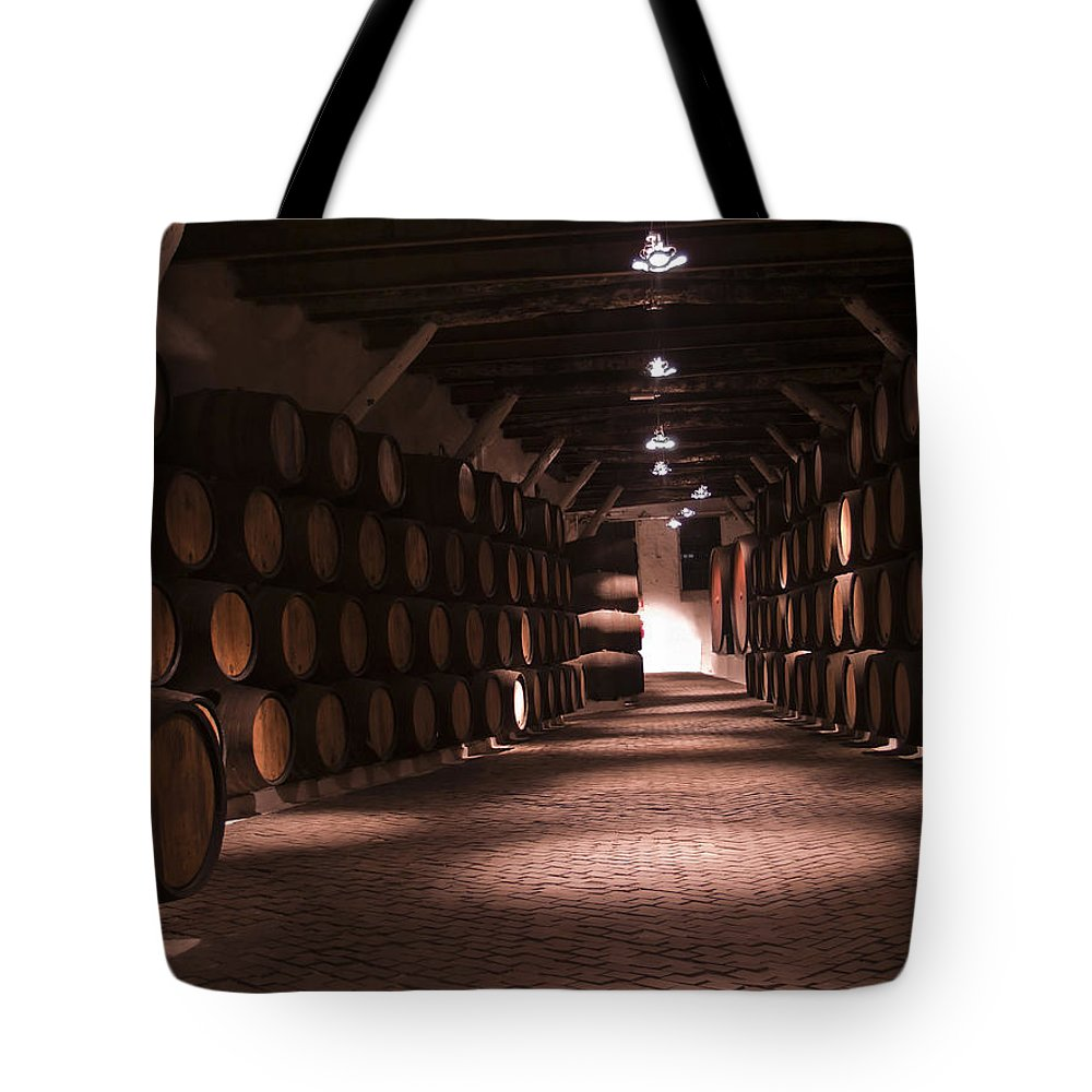 Barrels Tote Bag featuring the photograph Wine Barrels by Anastasy Yarmolovich
