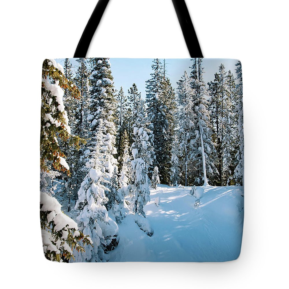 Yellowstone National Park Tote Bag featuring the photograph Winter In Yellowstone by Bob Phillips