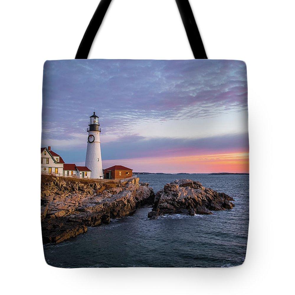 Lighthouse Tote Bag featuring the photograph Winter Sunrise Over Portland Head Light by Jesse MacDonald