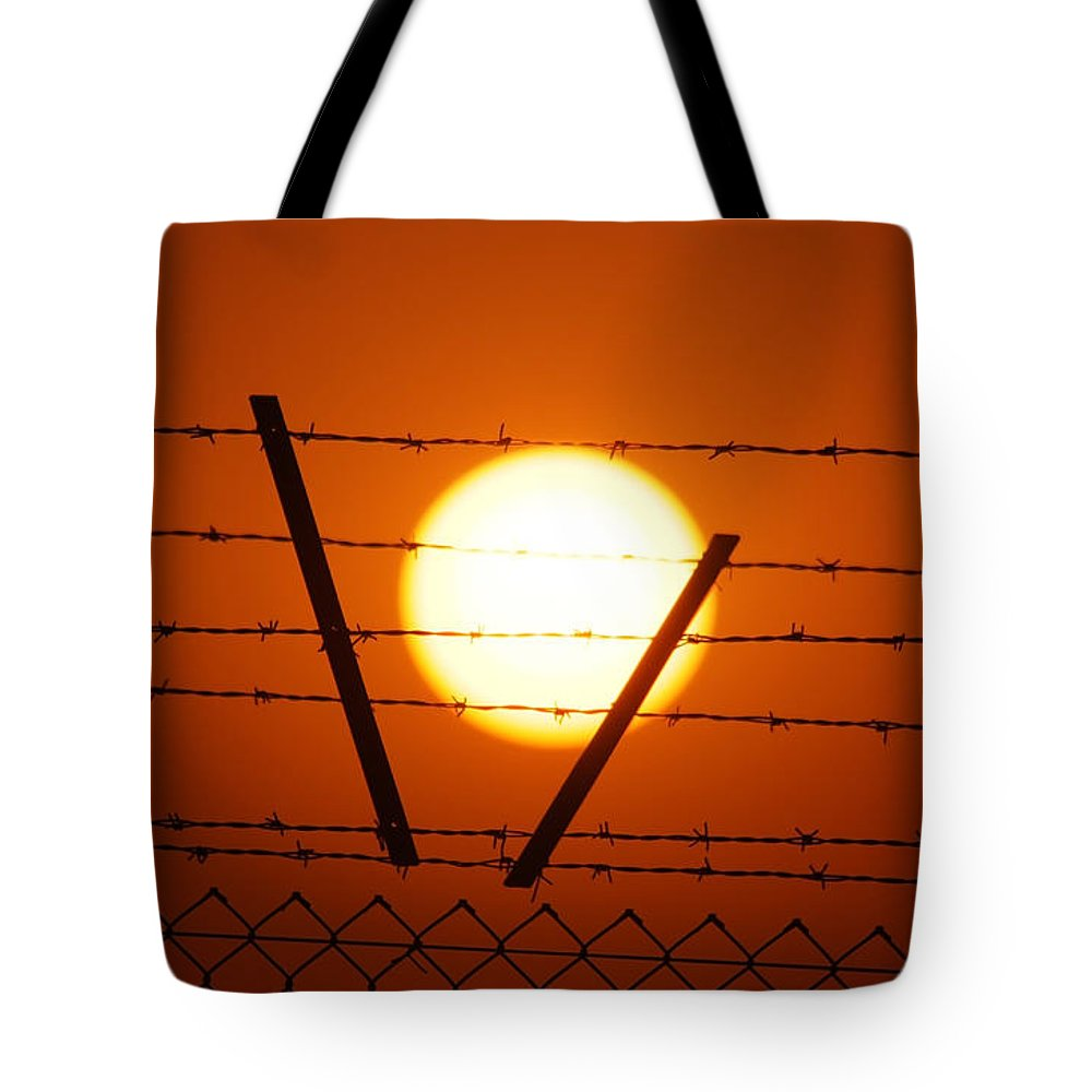 Sun Tote Bag featuring the photograph Wire And Sun by Cliff Norton
