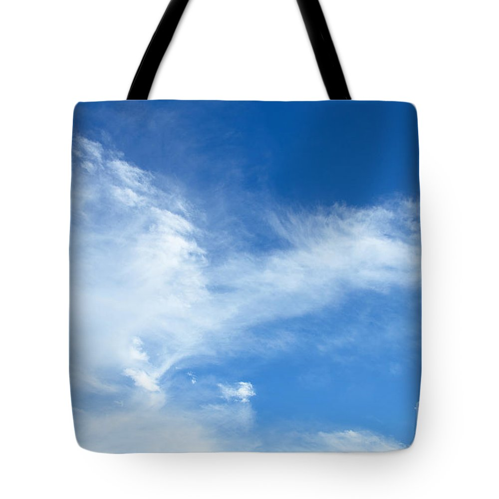Blue Sky Tote Bag featuring the photograph Wispy Clouds by Jennifer Booher