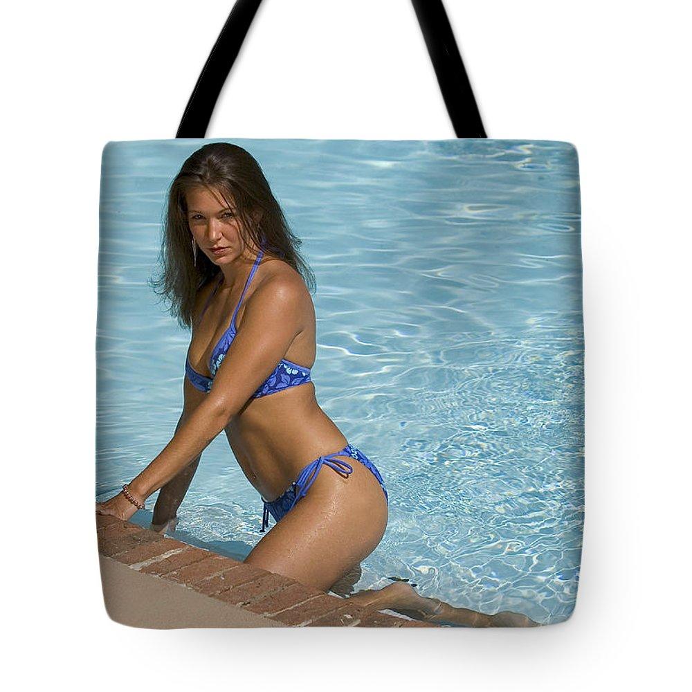 Bikini Tote Bag featuring the photograph Woman In A Pool. by Robert Ponzoni
