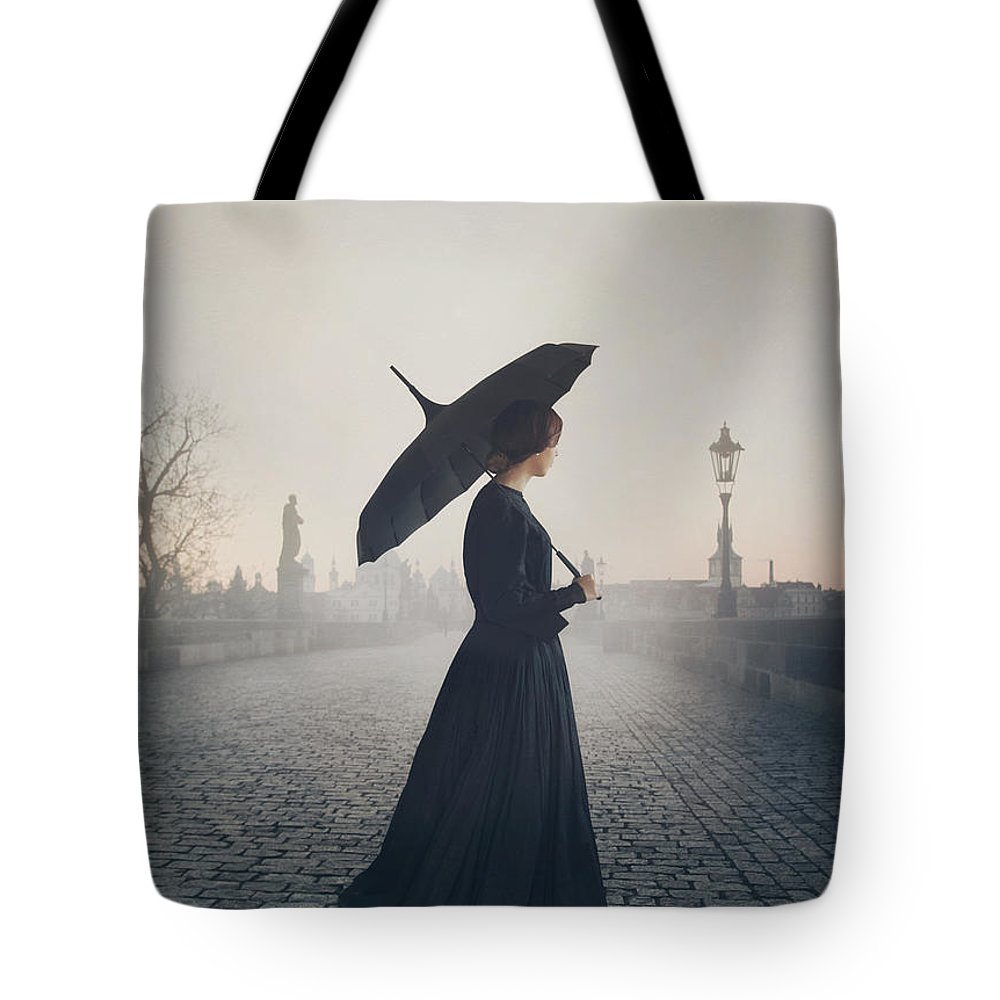 Woman Tote Bag featuring the photograph Woman In Mourning by Mark Owen