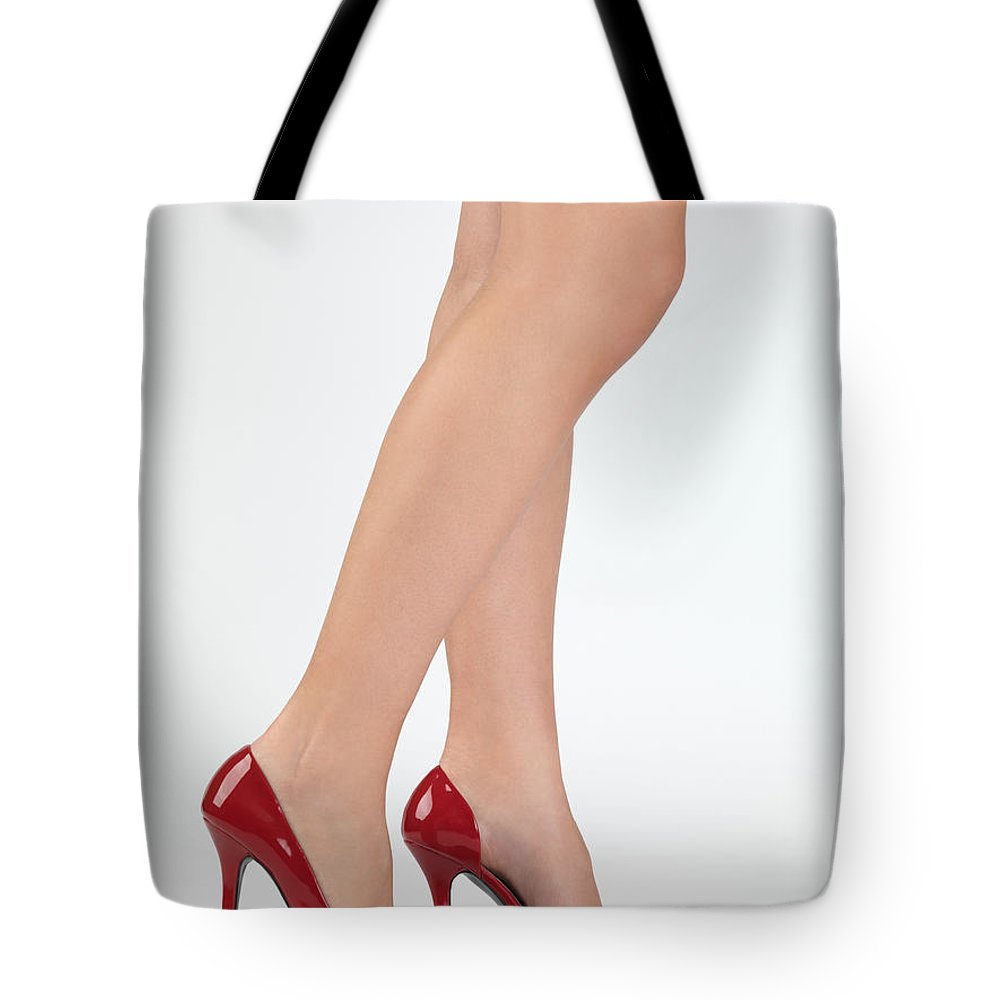 Legs Tote Bag featuring the photograph Woman Legs In High Heel Shoes by Oleksiy Maksymenko