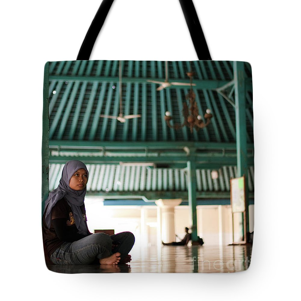 Indonesia Tote Bag featuring the photograph Woman On Mosque by Arie Toursino