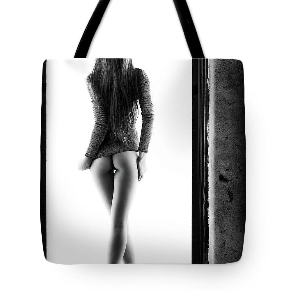 Woman Tote Bag featuring the photograph Woman standing in doorway by Johan Swanepoel