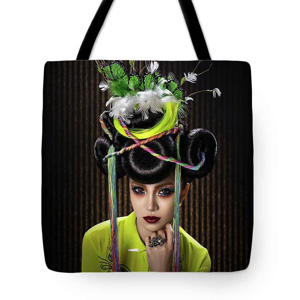 Yellow Dress Tote Bag featuring the photograph Woman With Yellow Dress With Feather And Leaf Headdress by Erich Caparas