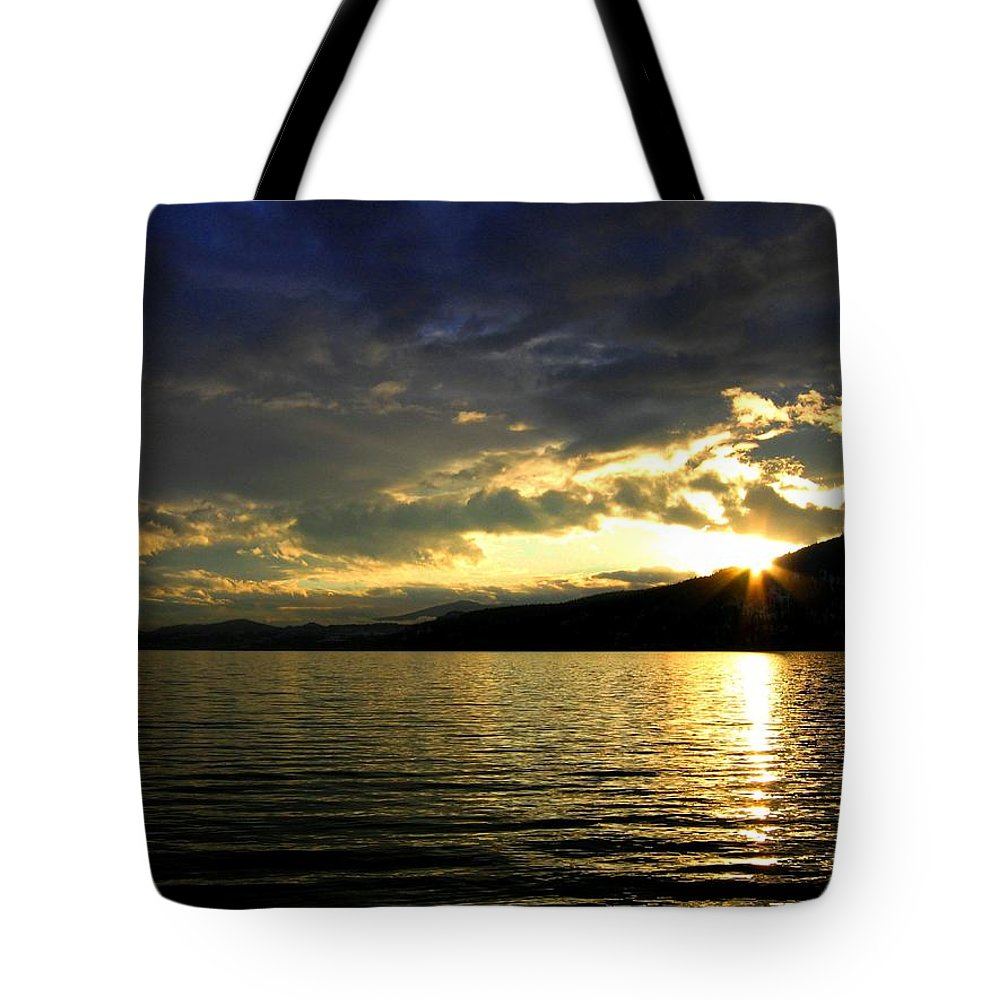 Sunburst Tote Bag featuring the photograph Wood Lake Sunburst by Will Borden