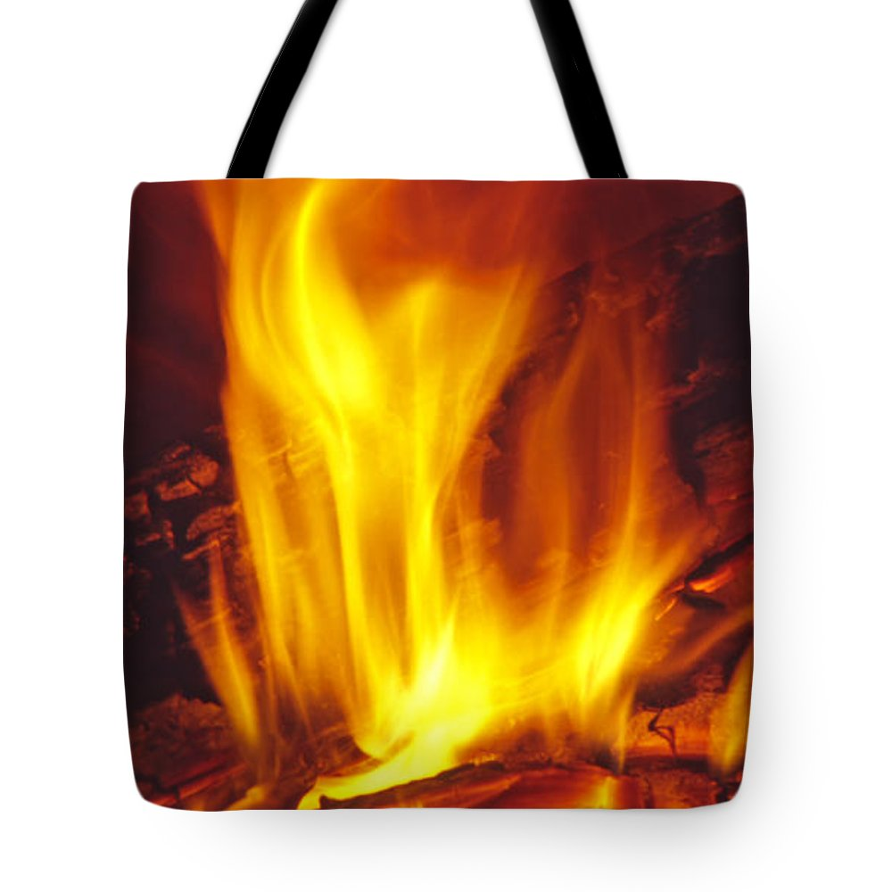Fire Tote Bag featuring the photograph Wood Stove - Blazing Log Fire by Steve Ohlsen