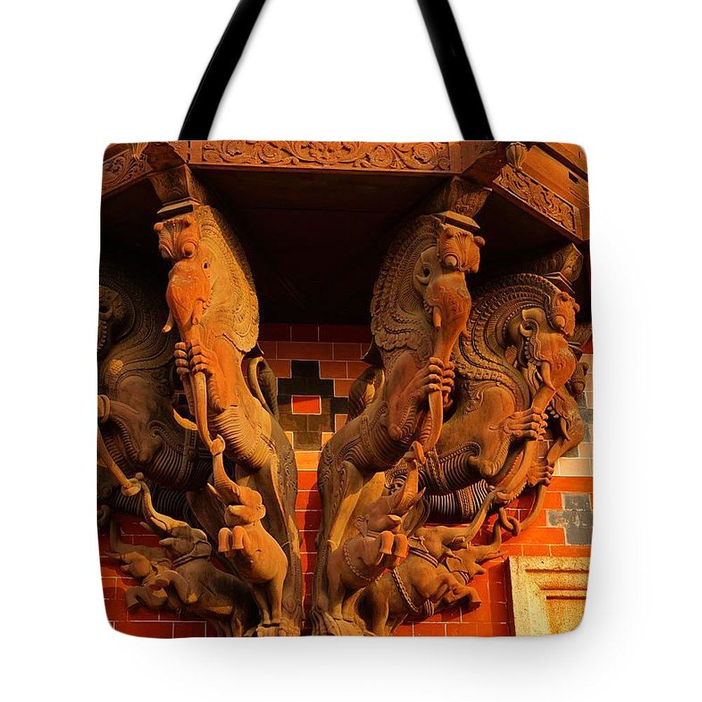 Elephant Wood Tote Bag featuring the photograph Wooden Elephants by Vijayan Madhavan