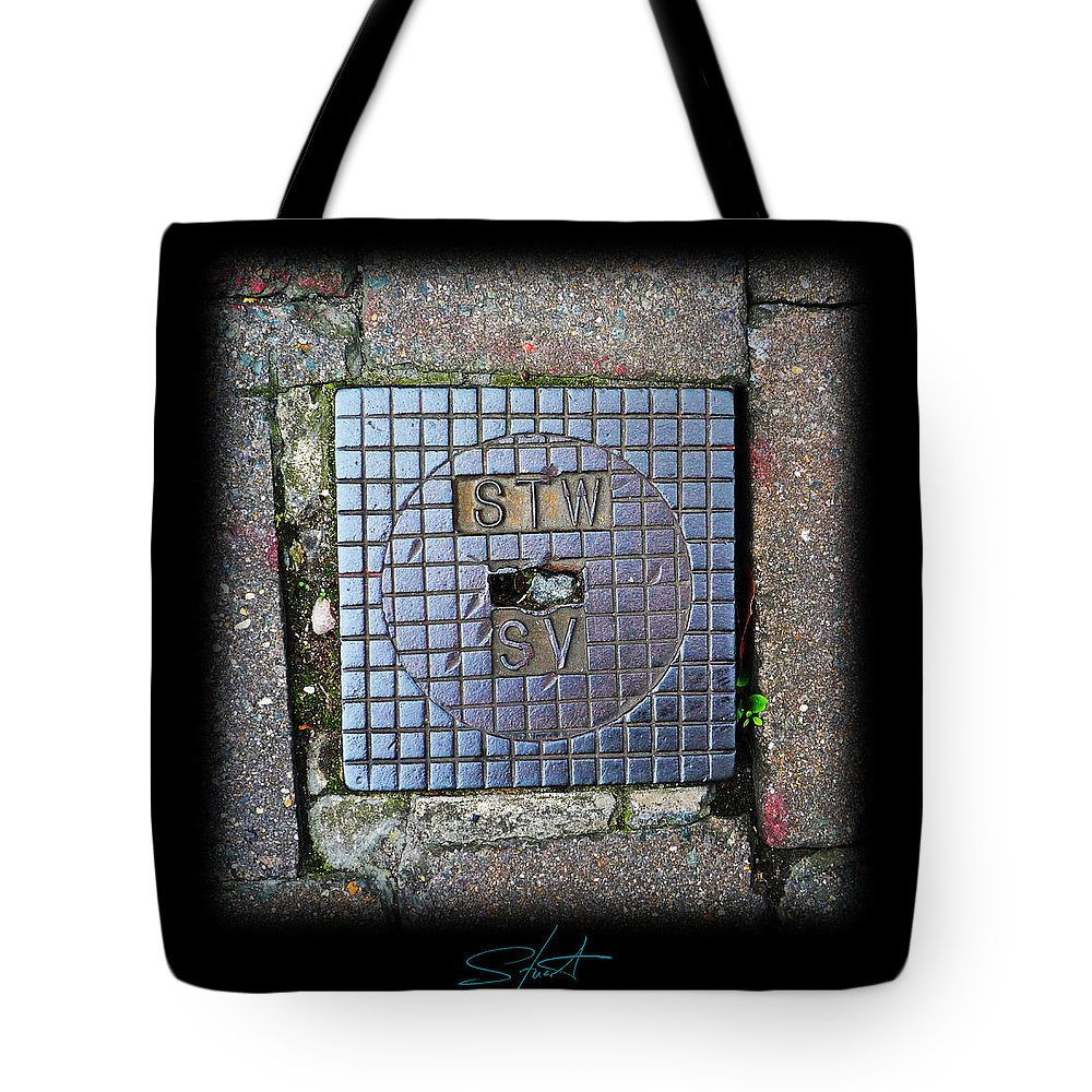 Cast Iron Tote Bag featuring the photograph World View by Charles Stuart