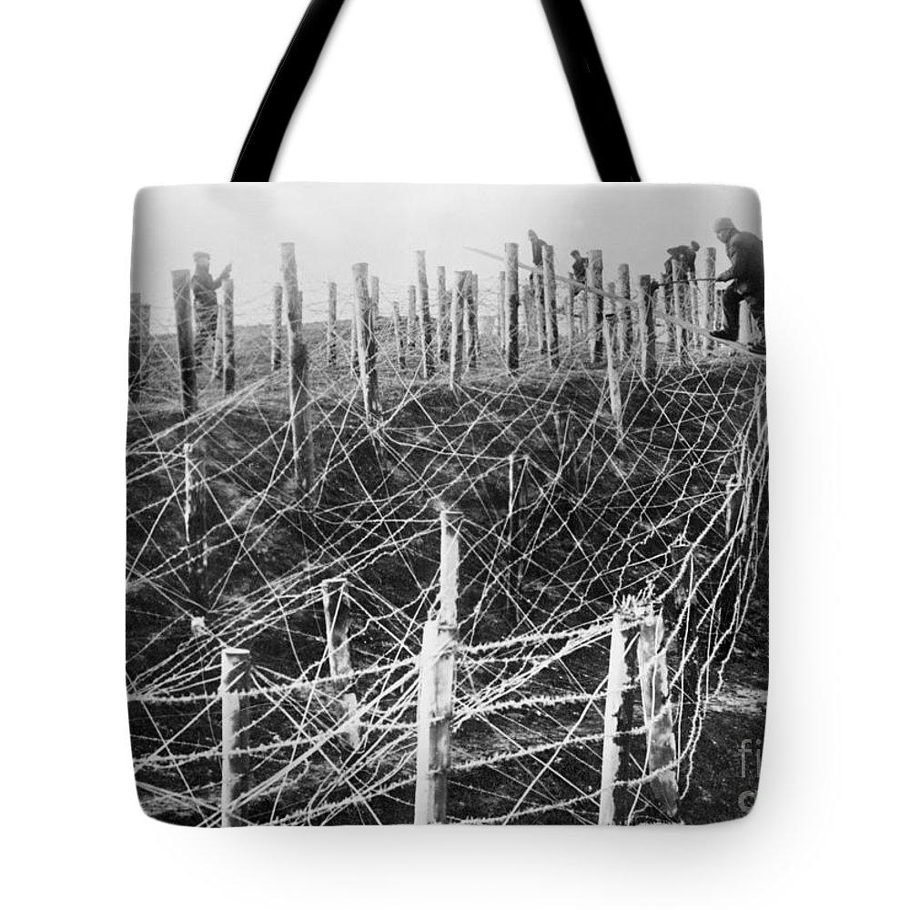 1914 Tote Bag featuring the photograph World War I Barbed Wire by Granger