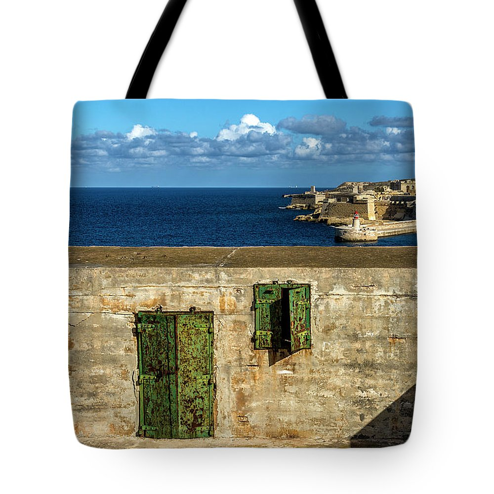 Europe; Malta Tote Bag featuring the digital art Ww2 Fortification Door by Tsafreer Bernstein