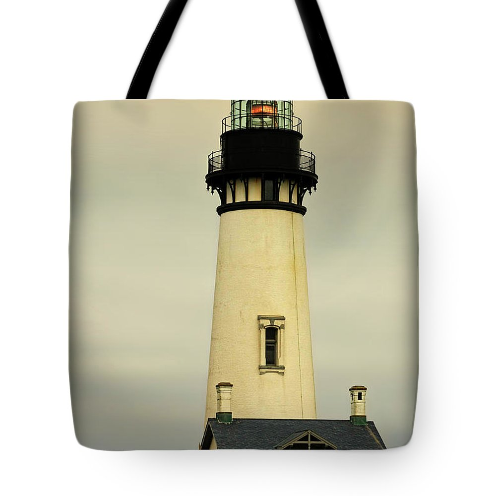 Yaquina Head Lighthouse Tote Bag featuring the photograph Yaquina Head Lighthouse - Newport Or by Christine Till