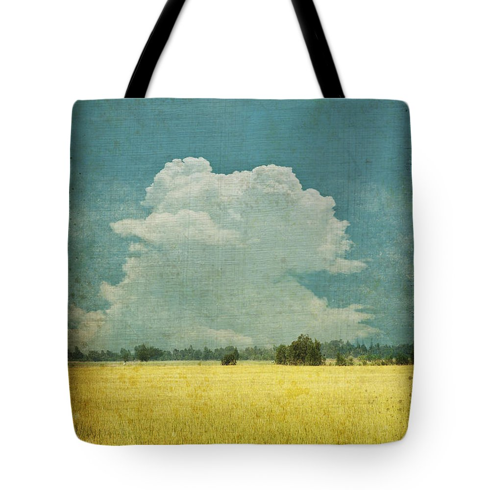 Abstract Tote Bag featuring the photograph Yellow Field On Old Grunge Paper by Setsiri Silapasuwanchai