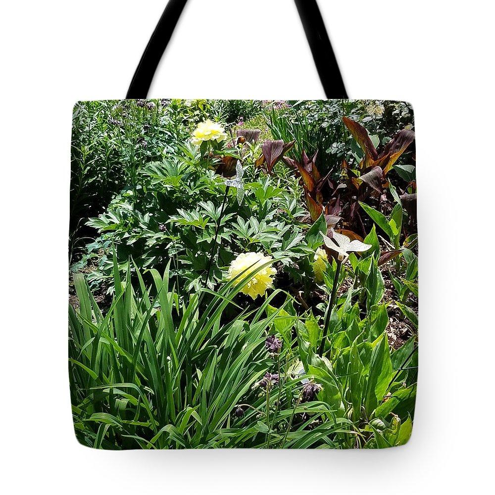 Tote Bag featuring the photograph Yellow Peonia by Teresa Doran