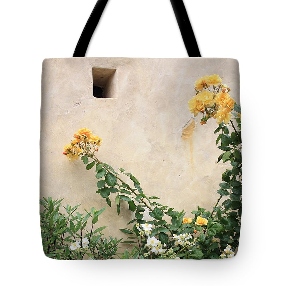 Yellow Roses Tote Bag featuring the photograph Yellow Roses And Tiny Window At Carmel Mission by Carol Groenen