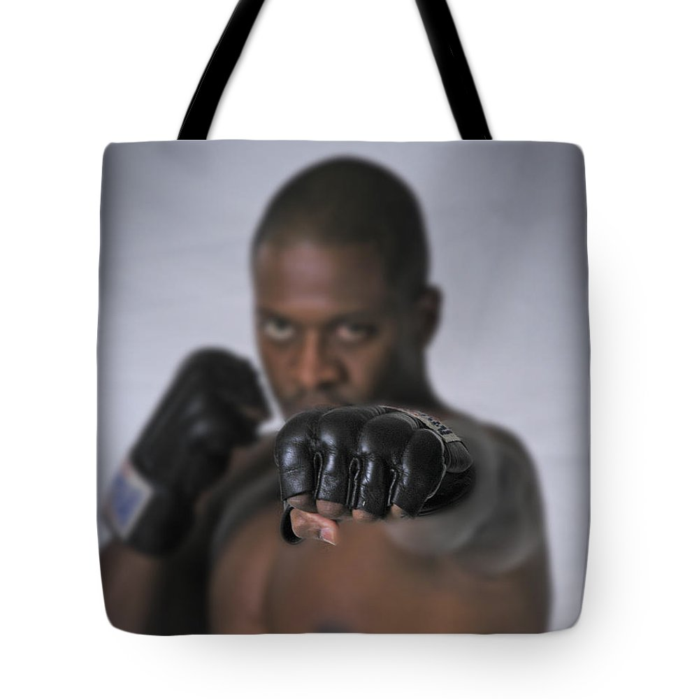 Fighter Tote Bag featuring the photograph Yes We Can by D'Arcy Evans