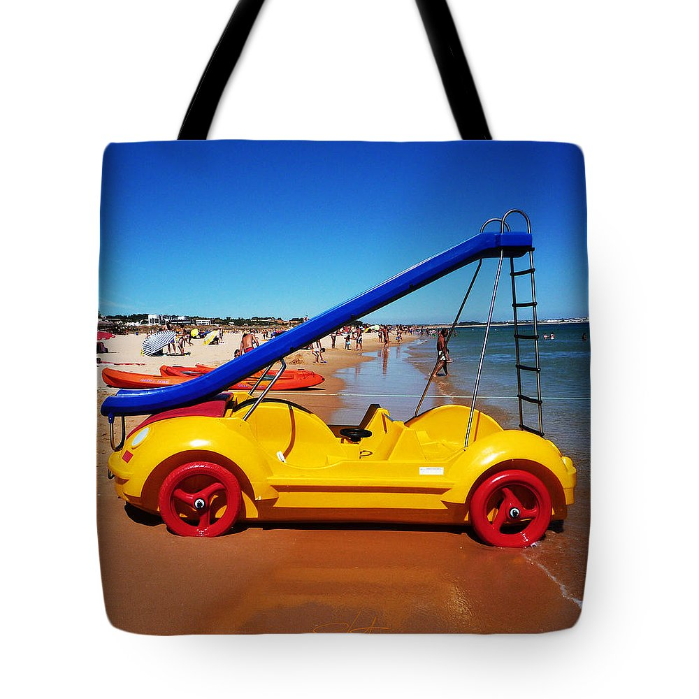 Noddy Car Tote Bag featuring the photograph You Are What You Drive by Charles Stuart