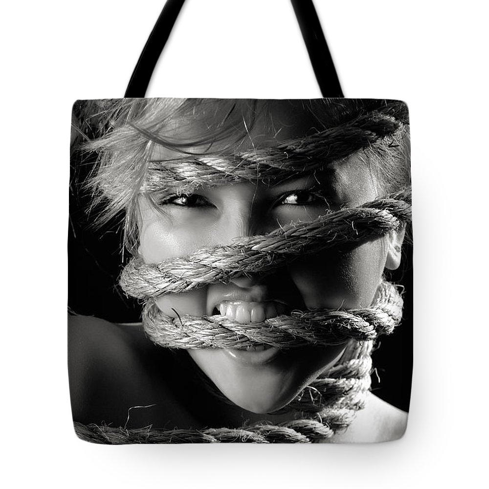 Angry Tote Bag featuring the photograph Young Expressive Woman Tied In Ropes by Oleksiy Maksymenko