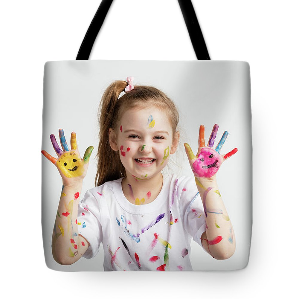 Girl Tote Bag featuring the photograph Young Kid Showing Her Colorful Hands by Michal Bednarek